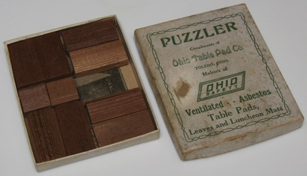 Ohio Table Pad Co., Copyright J. W. Hayward 1926. (cardboard Box And 9 Wood  Pieces, 4 By 3.25 By 7/16 Inches)